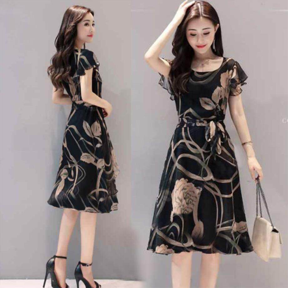 3a62f4918a8c Long Printed Short Sleeved Round Neckband A Skirt Shows A Thin Head.