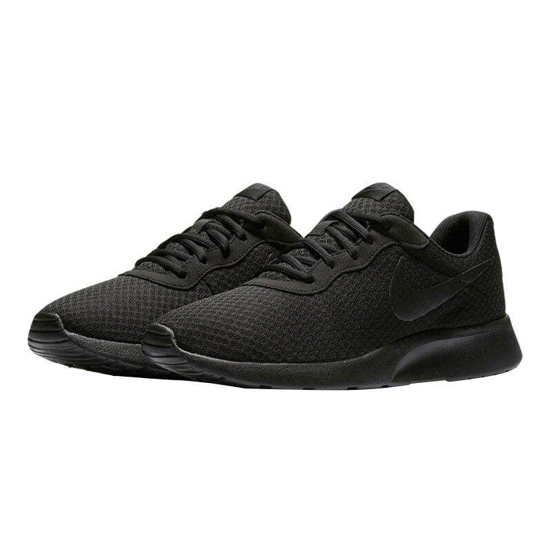 de7049 all black nike tanjun women
