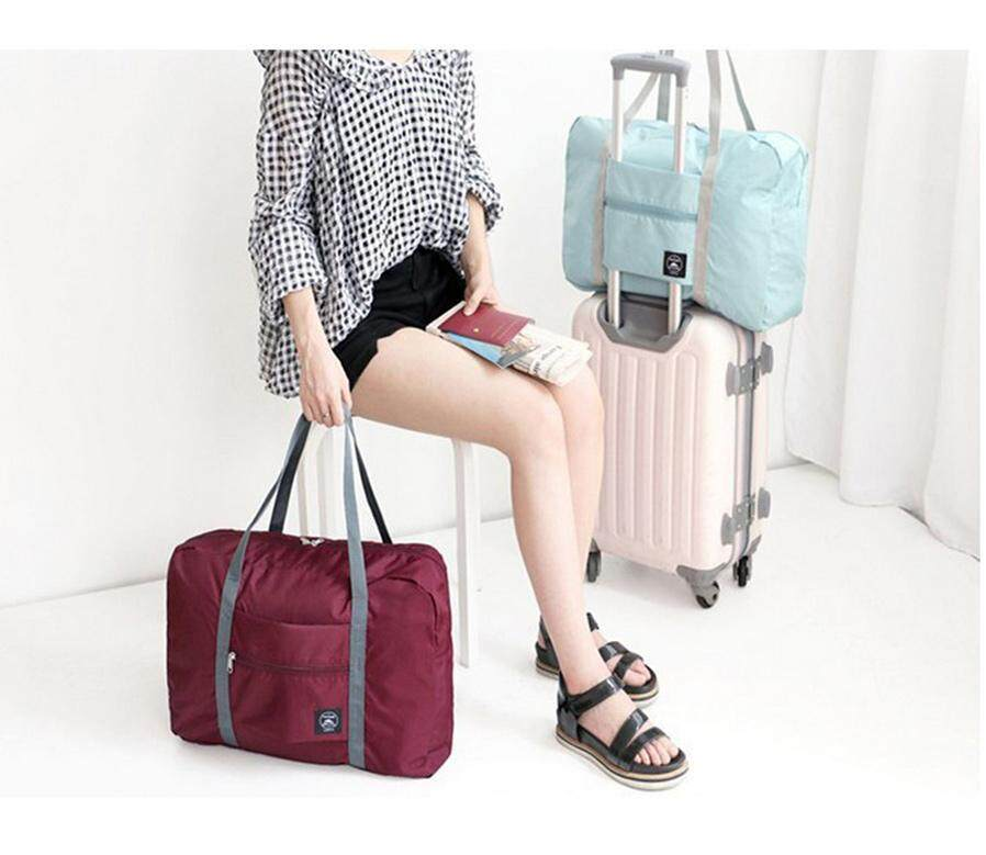 b29f6aba32cf Waterproof Nylon Travel Bags Women Men Large Capacity Folding Duffle ...