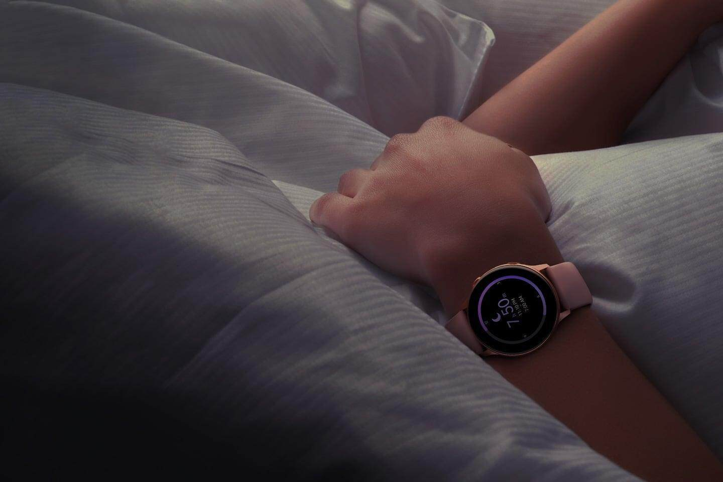 A person wearing a Galaxy Watch Active is sleeping.